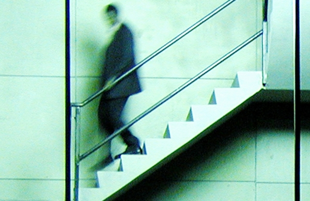 An image of a person walking down a flight of stairs.